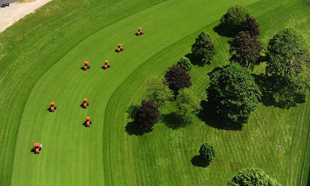 Mowers in formation on the first hole.