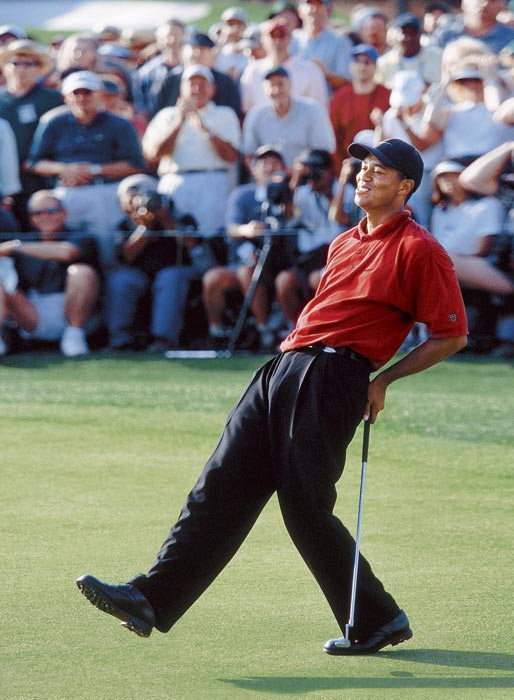 Woods defended his title in 2002 for his third green jacket.
