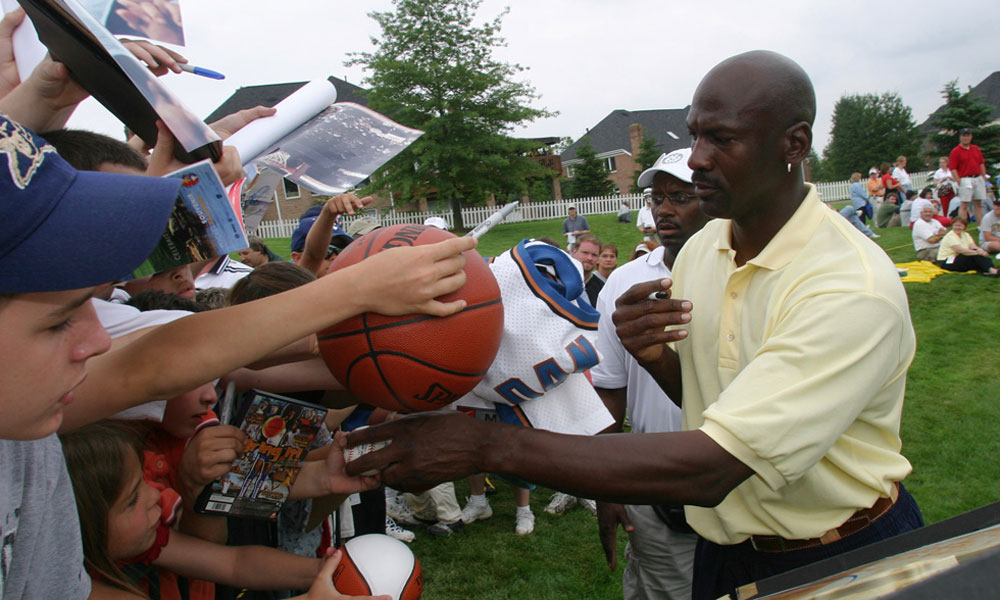 Jordan took time to sign autographs for fans at the 2003 Mellon Mario Lemieux Celebrity Invitational outside Pittsburgh.