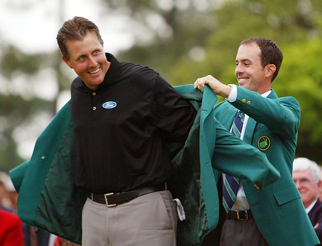 Fellow lefty Weir helped Mickelson into his green jacket.