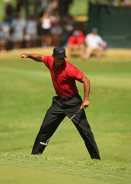 On Sunday at the par-3 eighth, Woods dropped a long birdie putt and added his trademark fist pump.