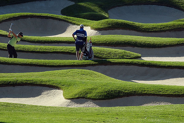 Padraig Harrington found himself in an ugly spot on the 12th hole Friday morning. The Irishman is five over.