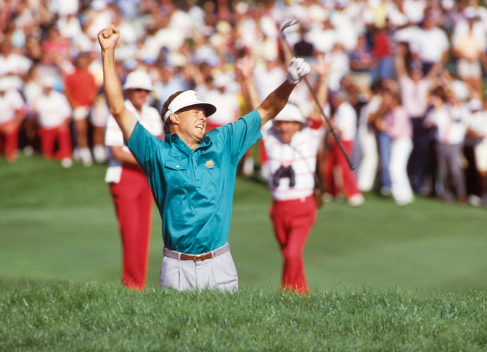 No. 3 | 1986:  Four shots back to Greg Norman with eight holes to play, Bob Tway caught him on the 14th. They arrived at the short par-4 18th tied, though it looked like Norman had the advantage when Tway bunkered his approach. First to play, Tway popped his sand shot over a steep lip—and holed it. He jumped up and down like a kid in a sandbox. When Norman couldn't match the birdie, Tway was the winner. Photo by Jacqueline Duvoisin /Sports Illustrated/