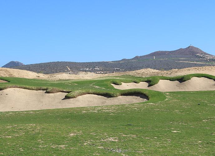 "3rd Fairway: A small, 4,400-square-foot target awaits the approach to El Cardonal's par-4 3rd, though strategically placed bunkers complicate matters. Tiger built a ramp on the left side of the green and in back of the green, ""so in case you blade one, you still have a backstop."""