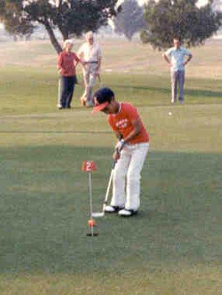 Woods on the putting green.