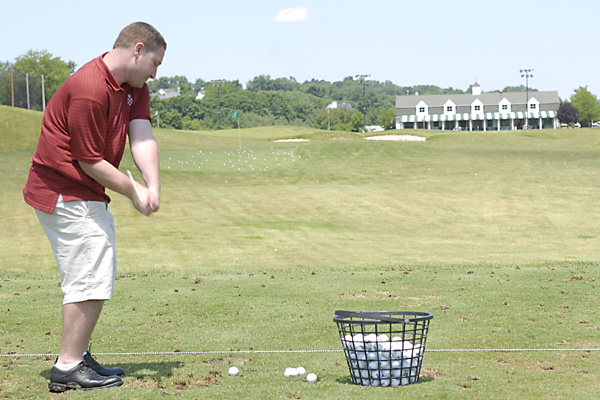 Chris Klamkin paints a pretty picture of one of Centennial's greens.