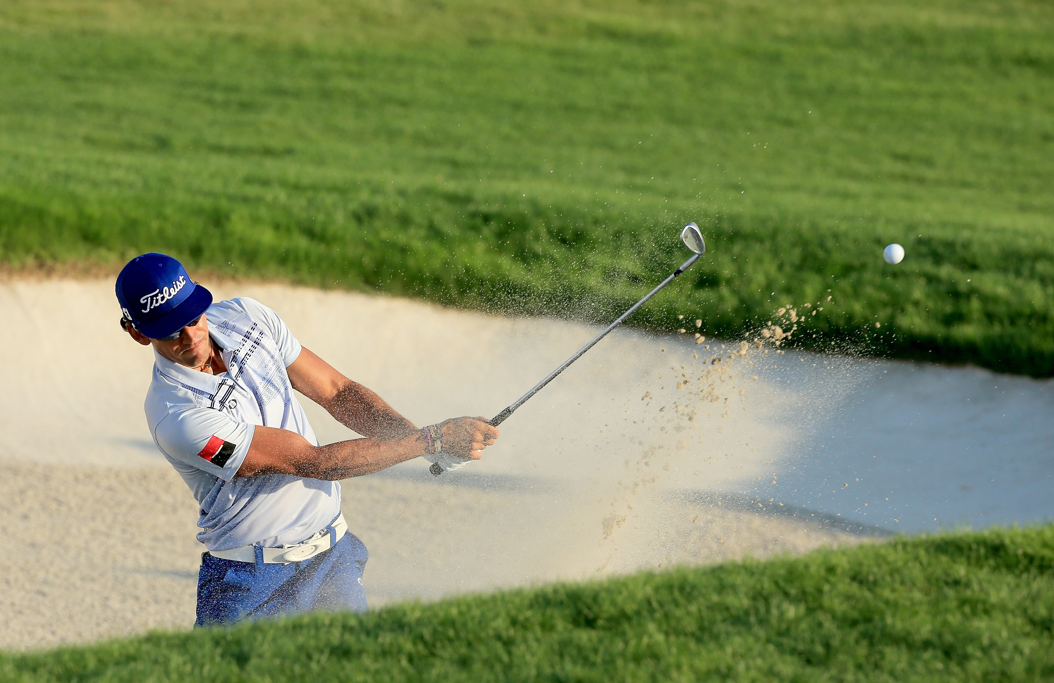 Rafa Cabrera-Bello of Spain plays his third shot at the par 5, 18th hole. Cabrera-Bello birdied four of his last five holes to finish 7-under with a 65. He currently shares the lead with Henrik Stenson.