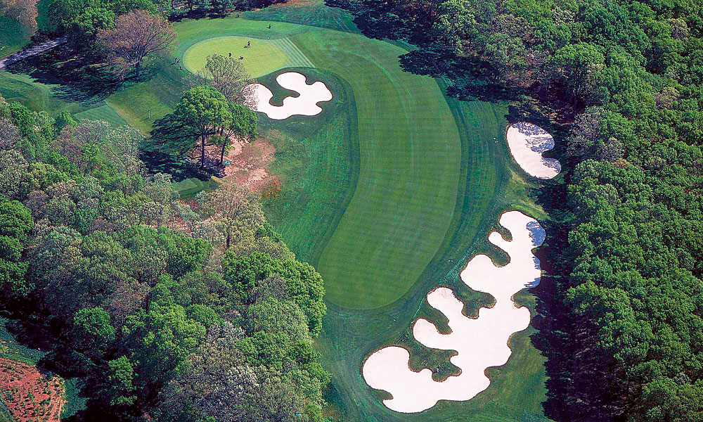 The fourth features the distinctive bunkering that the course is known for.