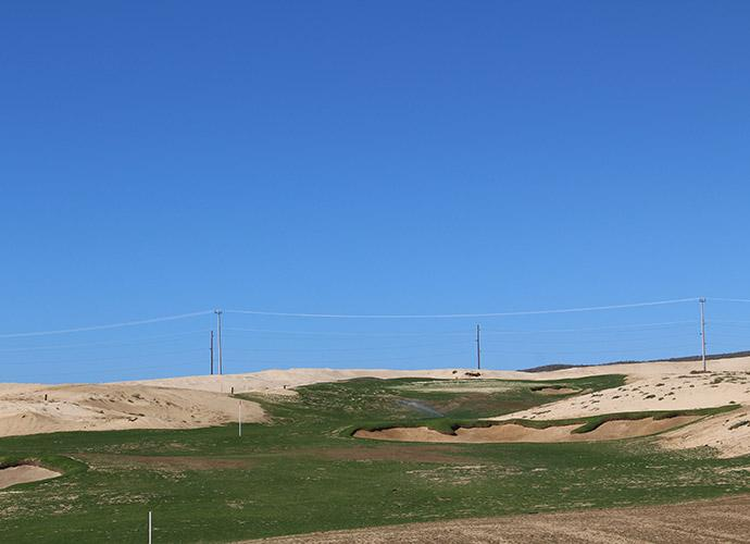 "4th Tee: ""This might be the toughest hole on the course,"" says Tiger. It's 485 yards, par-4 and plays uphill, with bunkers flashed-up in ""Old California"" style that eat into the fairway landing area. ""We've got big, bold bunkers, but we've built in ways to avoid them,"" he says."