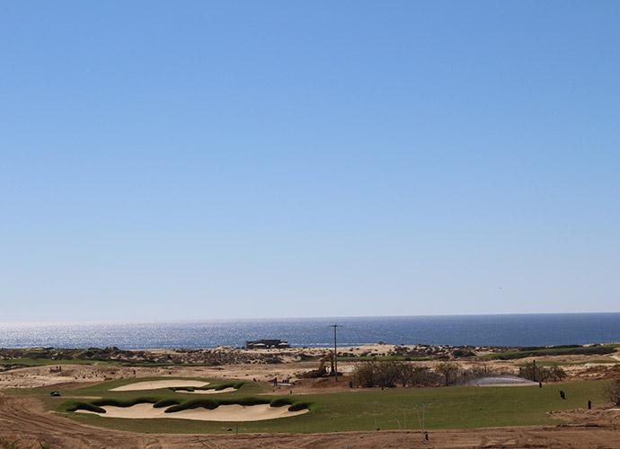 7th Tee: From a grove of Cardon Cacti behind the tee box, this downhill 500-yard par-4 features an outstanding view of the Pacific Ocean in the distance. A helping contour short of the green shortens the hole considerably for those who wish to run it onto the green.