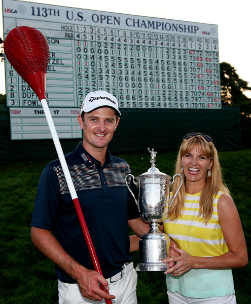 Justin Rose celebrates alongside his wife Kate Phillips while holding the U.S. Open trophy and a wicker basket flagstick after winning the 113th U.S. Open at Merion Golf Club on June 16, 2013 .