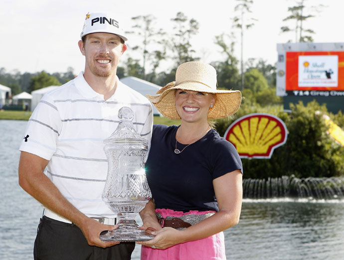 Hunter Mahan holds the winners trophy with his wife, Kandi, on the green of the 18th hole after the final round of the Shell Houston Open at Redstone Golf Club on April 1, 2012.