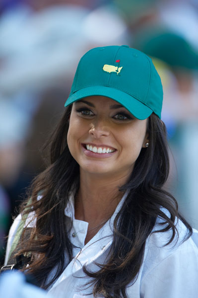 Amber Watney smiles as she caddies for husband, Nick Watney, during the Masters Par 3 Contest.