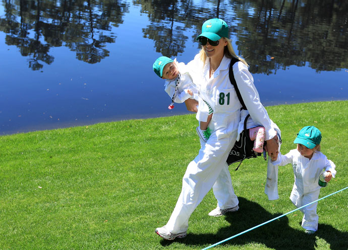 Richelle Baddeley walks with her daughters Jewell and Jolee during the Par 3 Contest prior to the 2011 Masters Tournament at Augusta National Golf Club.