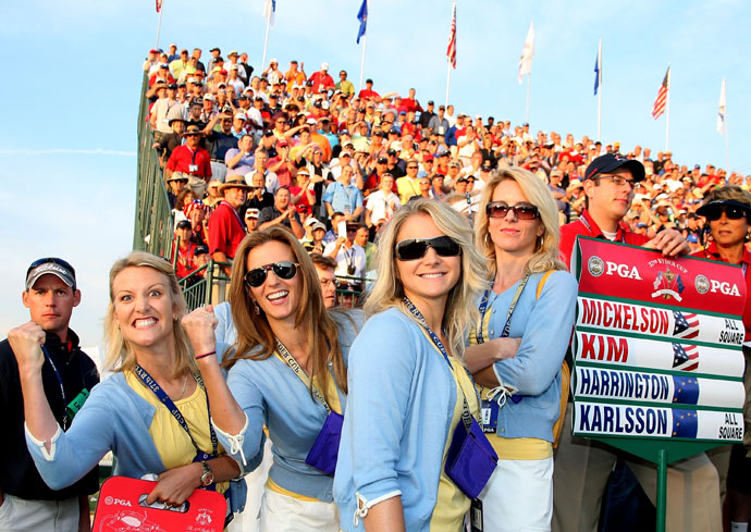 Henrik Stenson's wife, Emma, Justin Rose's wife, Kate, the partner of Oliver Wilson, Laura Smith, and Valerie Faldo smile on the first hole during the morning foursomes on day one of the 2008 Ryder Cup at Valhalla Golf Club.