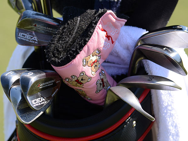 Aaron Baddeley is currently using Adams prototype muscleback irons. He's been using the pink, teddy bear-covered putter headcover for years.