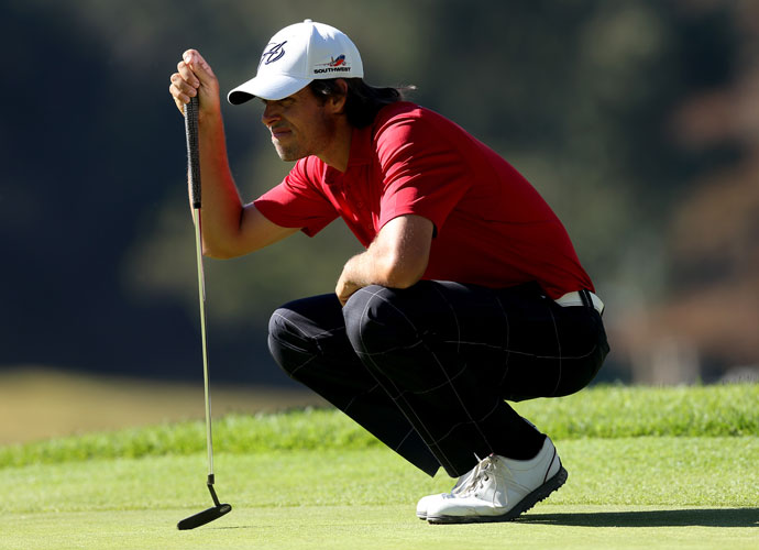Aaron Baddeley of Australia lines up his putt on the 8th green in the second round. 'Bads' shot 65 and was a shot back of leader Bae Sang-Moon.