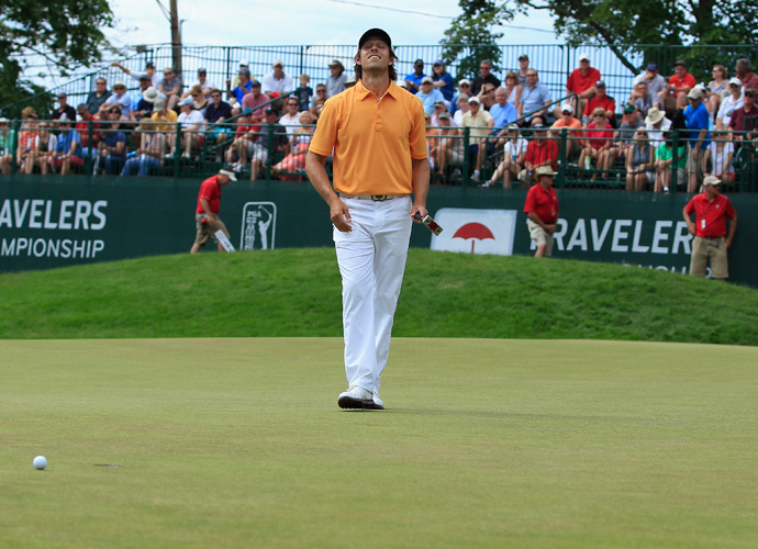 Aaron Baddeley of Australia reacts to a missed putt. He fell to fourth at 13-under after shooting a 1-under 69.