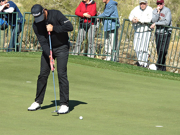 Adam Scott put a Scotty Cameron for Titleist Studio Select Kombi broomstick putter in his bag.