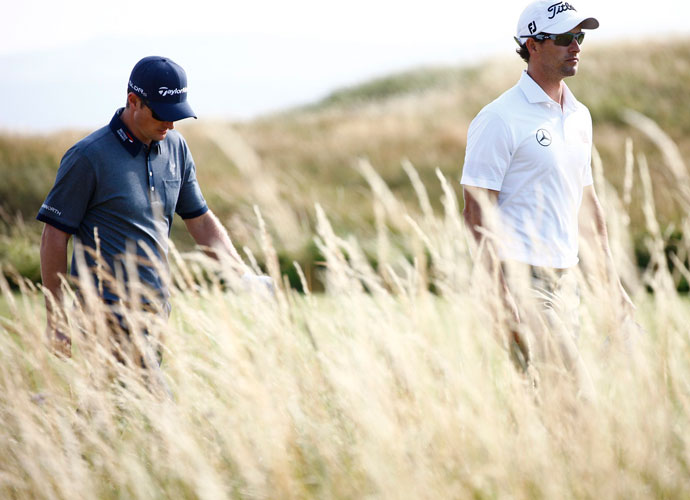 Adam Scott (right), the world's top-ranked player, opened with a four-under 68. Playing partner Justin Rose shot an even-par 72.