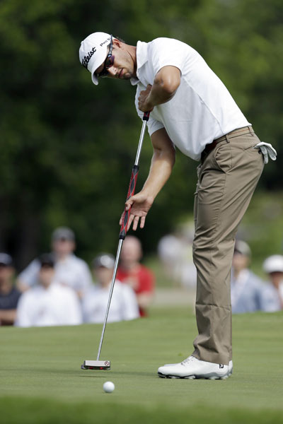 Adam Scott, the No. 1 player in the official World Golf Rankings, putts on the ninth hole.