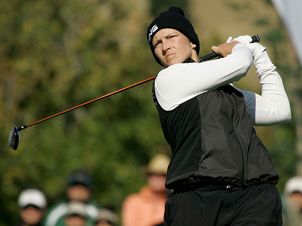 Although she was bundled up against the wind and chilly temperatures, Angela Stanford's game remained hot as she shot 67. She is one stroke behind Kim.