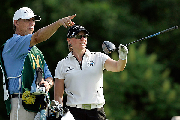 Annika Sorenstam and her caddie, Terry McNamera, plotted strategy before she hit her tee shot on the ninth hole. She would go on to par the hole and shoot 68 to finish four shots off the lead.