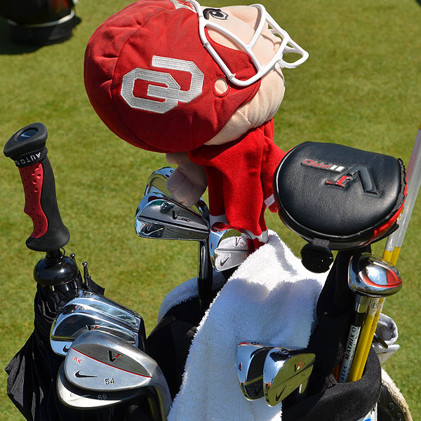 Anthony Kim Nike VR Pro Blade irons are watched over by a University of Oklahoma football player.