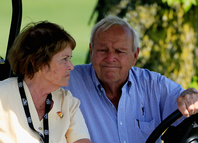 Arnold Palmer and his wife Kit cruised the course in a golf cart.