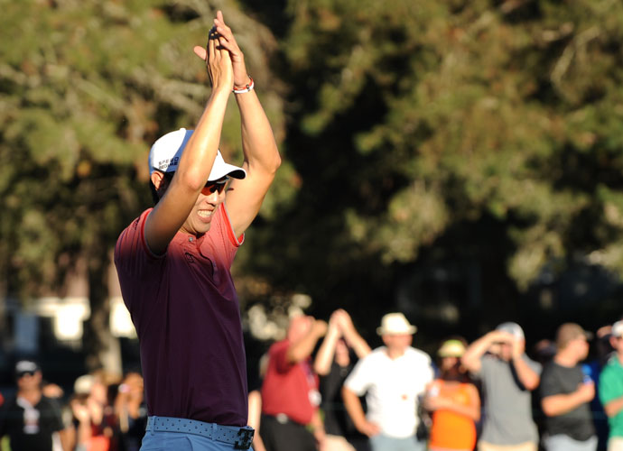Bae acknowledges the crowd on the 18th green after securing the title.