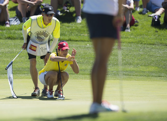 Beatriz Recari lines up a putt during Spain's Day 2 match against the United States.