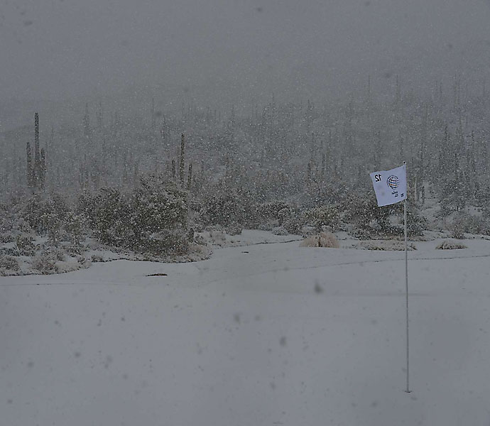 A freak February storm hit the high desert on Wednesday, suspending play during the first round of matches.
