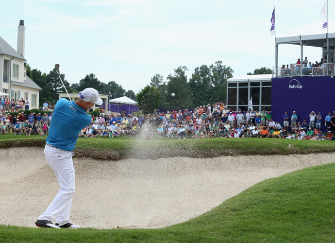 Crane chips out of a bunker on the 18th hole. He would two-putt for bogey to finish at 10-under 270.
