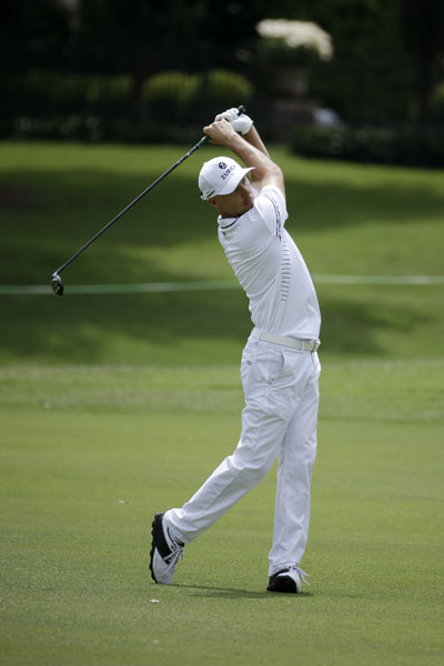 """Ben Crane hits an approach shot from the 17th fairway. """"I started to feel like I was a little more in control of my ball, just felt like I was tightening my draws and fades a little bit,"""" he said. """"I had access to some holes I haven't this year and so gosh, it's been an incredible two days."""""""