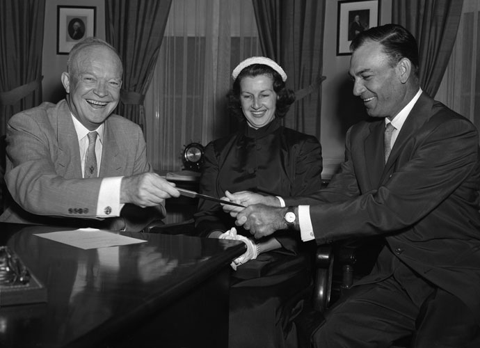 Ben Hogan, with wife Valerie, gives President Dwight Eisenhower a grip lesson during a visit to the White House in August 1953. The visit was part of Hogan's triumphant summer, which included a ticker-tape parade in New York after he won the British Open, his third consecutive major victory.