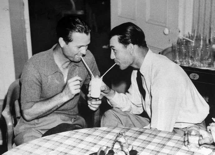 Friends Jimmy Demaret and Ben Hogan jokingly share a glass of milk in the Augusta National clubhouse in the 1940s. The gregarious, fun-loving Demaret had a markedly different personality from the serious, efficient Hogan.