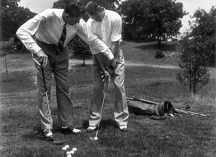 Henry Picard works with Ben Hogan's strong grip on Long Island in July of 1939. Picard helped Hogan with his game early in his career and is credited with convincing Hogan to use a weaker grip. Picard won the 1938 Masters and 1939 PGA Championship.