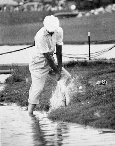 Ben Hogan blasts out of the water in front of the 17th green during the final round of the classic 1960 U.S. Open at Cherry Hills Country Club in Denver. Hogan laid up on the par-5 and hit a wedge approach that had too much spin and rolled back into the water. He bogied the hole and finished tied for ninth (E) behind winner Arnold Palmer (-4) and runner-up Jack Nicklaus (-2).                            Here's more on the 1960 U.S. Open from Golf.com.