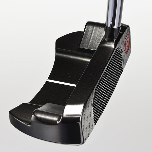 "Bettinardi Studio Stock #7, $375; bettinardigolf.com                                              Bob Bettinardi, President/CEO and chief designer at Bettinardi Golf, was ""messing around"" with a mallet putter in his design studio when he decided to cut a half-moon shape in the flange. ""Actually, it looked great the first time around,"" says Bettinardi, ""so I decided to put it in the line."" The Studio Stock #7, made of carbon steel, has a horizontal pattern milled into the face (it's not an insert) for a pure, soft impact feel. The package is topped off with a striking ""borealis black"" finish. By contrast, the company's BB Series (carbon steel) features a ""metallic fog"" finish, and its Signature Series (stainless steel) has a ""Tour satin"" finish."