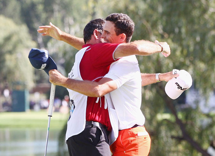 Horschel embraces his caddie, Micah Fugitt, on the 18th green.