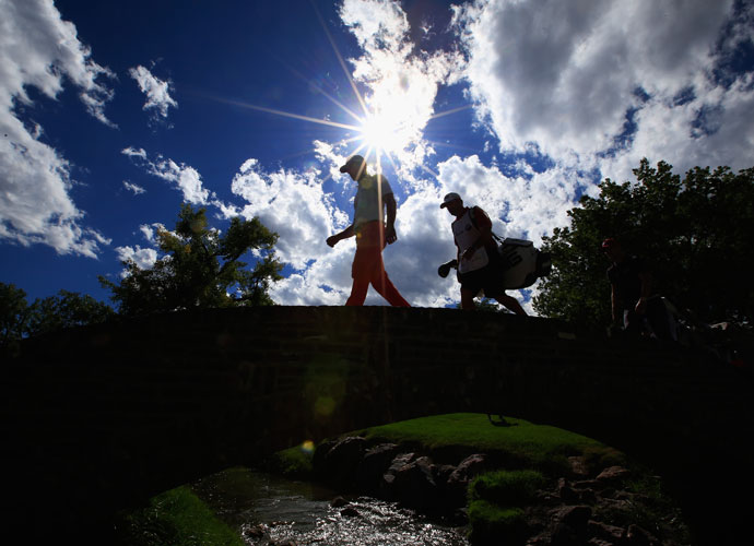 Horschel and Fugitt cross a bridge during the final round.