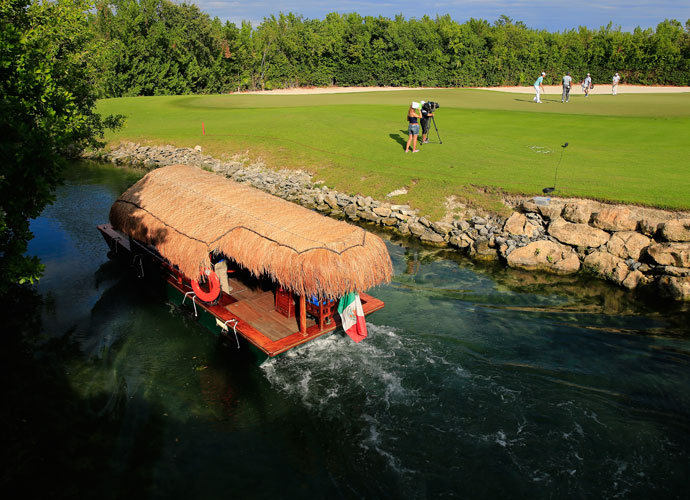 A boat navigates the canal behind the 16th green during the second round of the OHL Classic.
