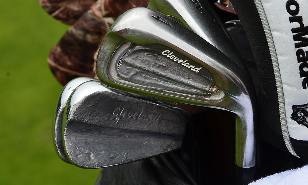 Boo Weekley's Cleveland CG1 and CG16 irons are so covered with lead tape that they are almost unrecognizable.