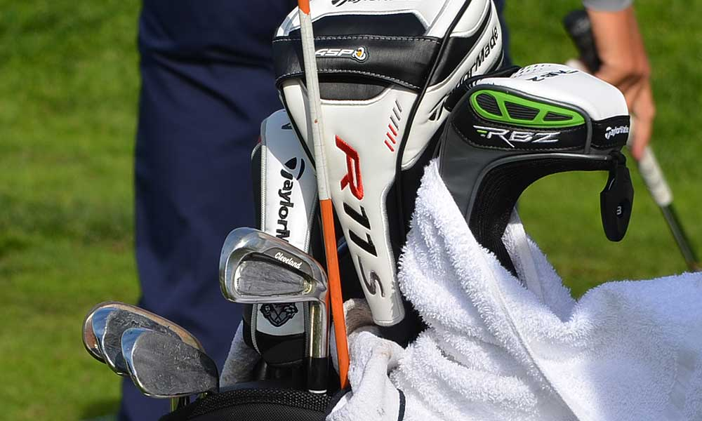Boo Weekley's venerable Cleveland irons have lead tape slathered all over them.