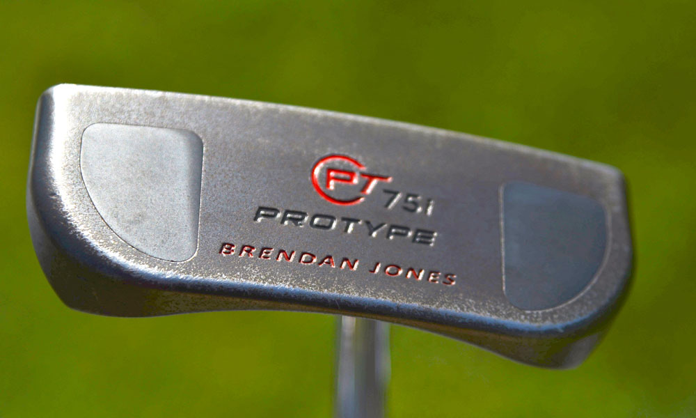 Brendan Jones putts with a customized Odyssey PT 75i prototype putter that features large weights in the sole of the heel and toe.