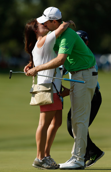 The 28-year-old Todd celebrates his first PGA Tour win with his wife Rachel.