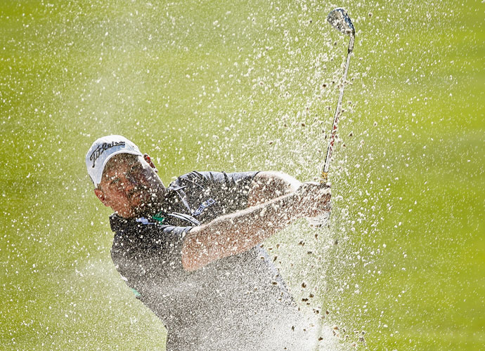 Brendon de Jonge blasts out of trouble on the way to his second-round 64.