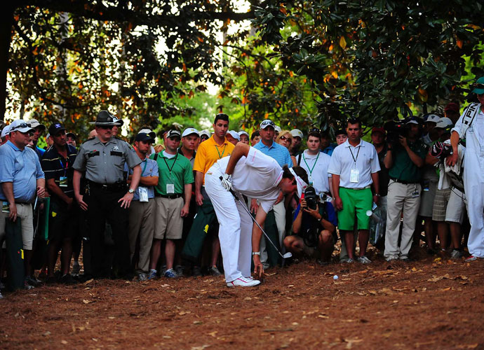 2012 Masters                             Bubba Watson's greatest recovery shot, and one of the greatest escapes from trouble in the history of the game, is his shot from the pine needles during the 2012 Masters. Here, he checks out his lie before crafting a shot.