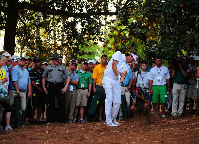 2012 Masters                             Surrounded by Masters patrons to the right of the 10th fairway at Augusta National, Bubba rips a gap wedge from the pine needles during his playoff with Louis Oosthuizen.