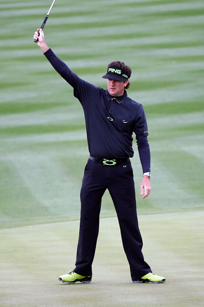 Bubba Watson celebrates his birdie on the eighth hole during the second round of the Waste Management Phoenix Open on Friday. Watson shot 64-66 to enter the weekend tied for the lead with Matt Jones at -12.
